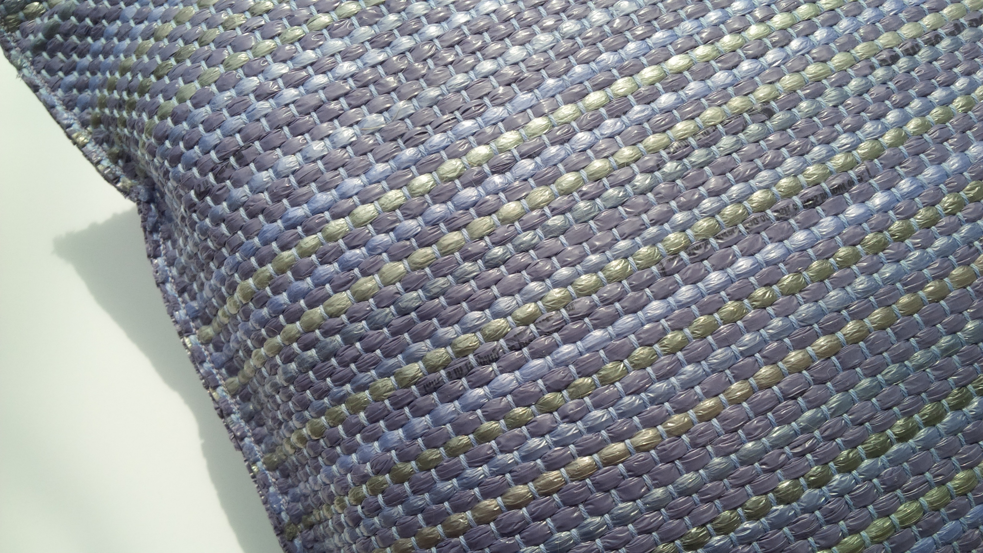 Purple and beige pillow