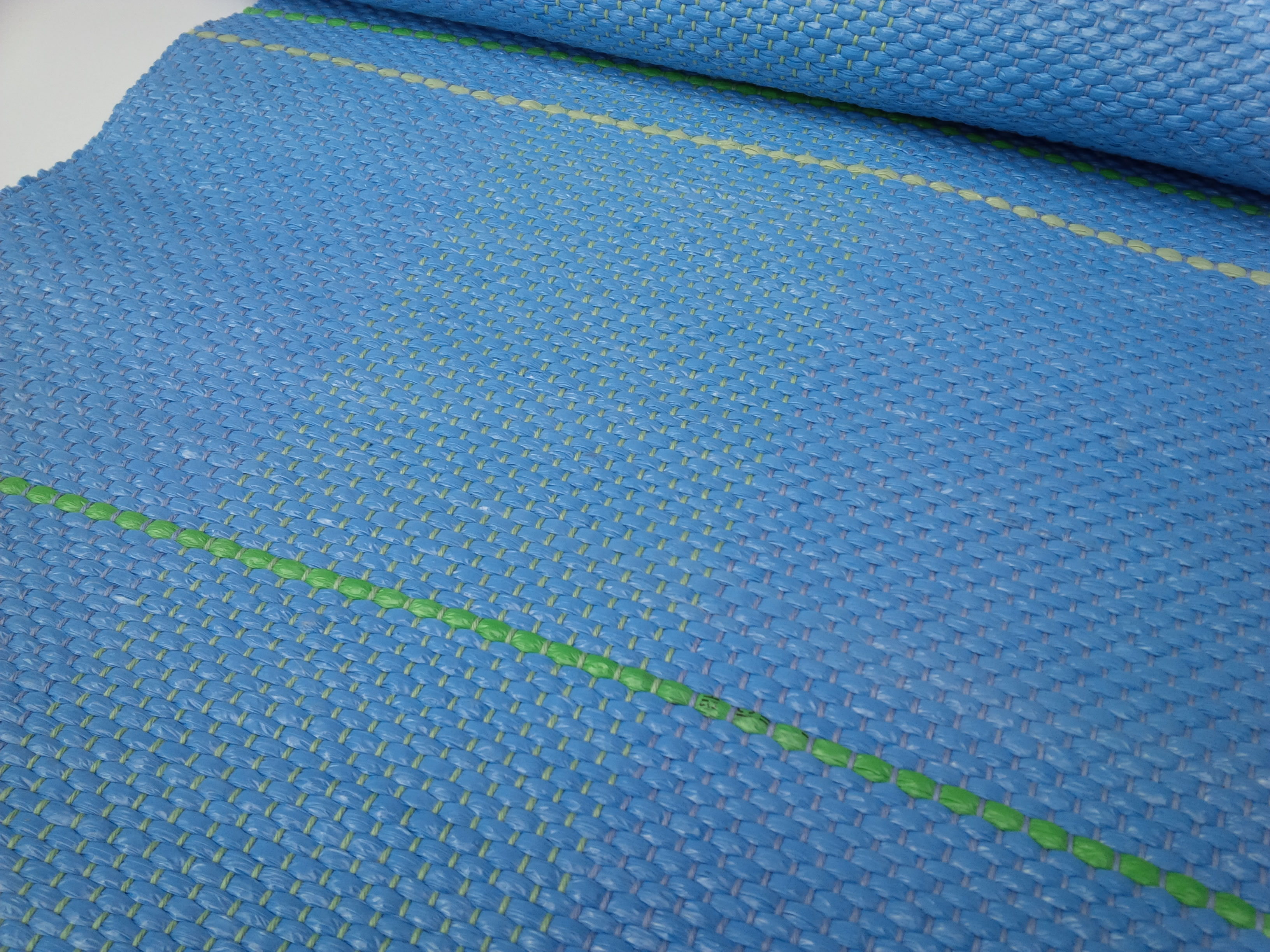 Blue runner with green and gray stripe