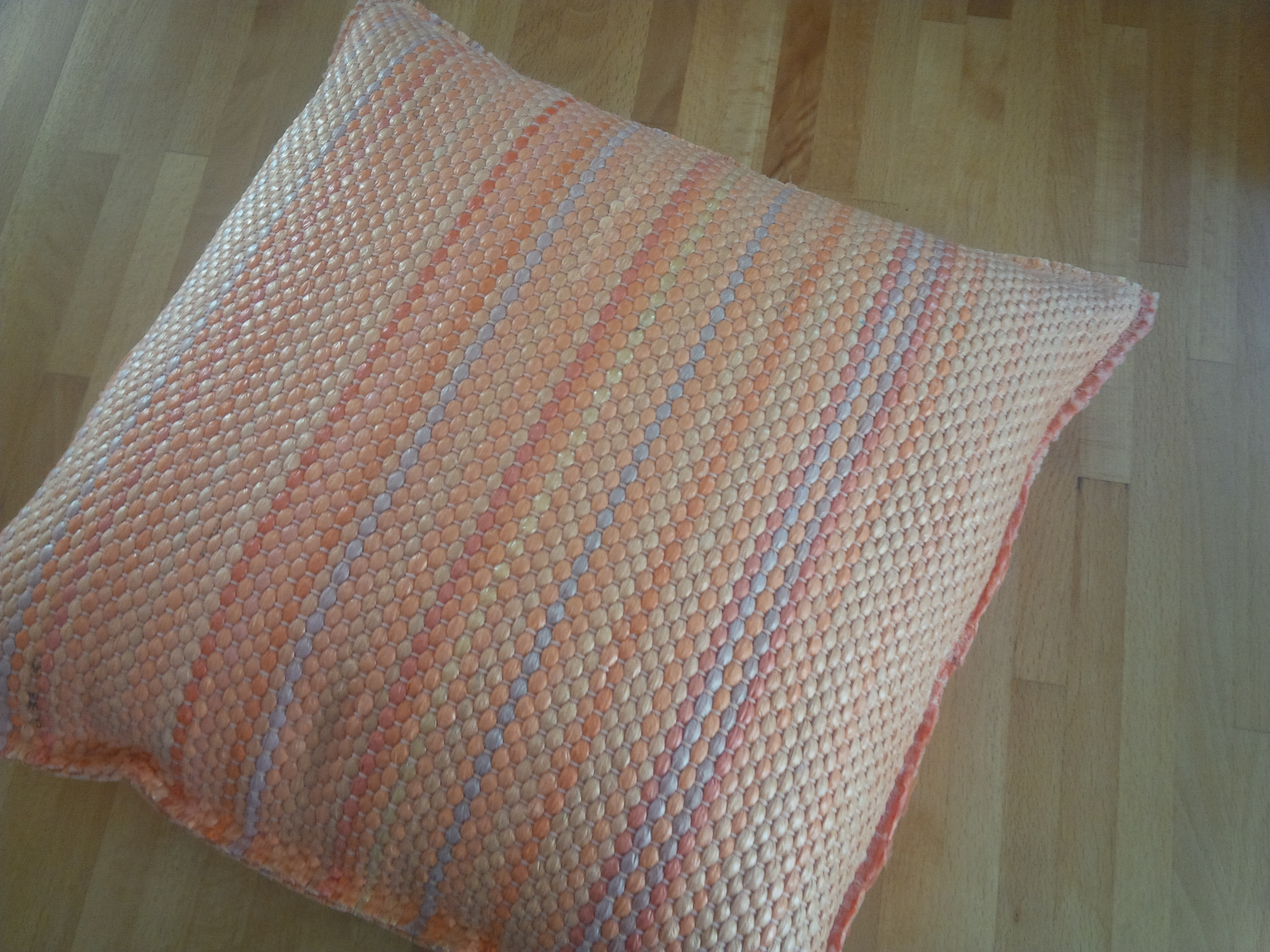 orange pillow on table